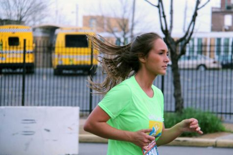Running a half marathon, Magalie Thauvette (12) shows how her training pays off.