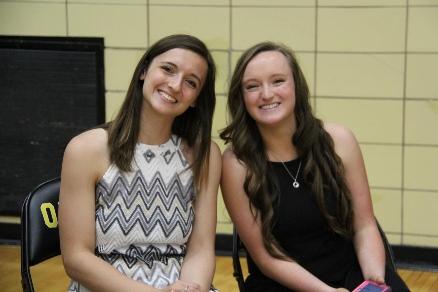Posing for a picture before giving their speeches at the Spring Pep Assembly on April 28, Sydney Stern (11) and Taylor Zapf smile at the camera.