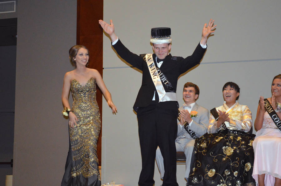 Raising+his+arms+in+celebration%2C+Prom+King+Austin+Hallet+%2812%29+acknowledges+the+crowd.++