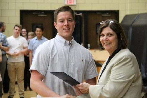 Jacob Paule (12) smiles at the camera with Principal Jan Kellerman