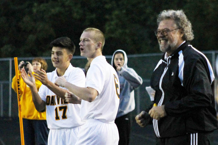 Varsity soccer coach Dave Robben celebrates a goal with Matt Greubel and Samed Ganibegovic in a 3-2 win over Marquette, Sept. 11 at OHS. The victory gave Coach Robben his 500th win as the boys soccer coach at Oakville.