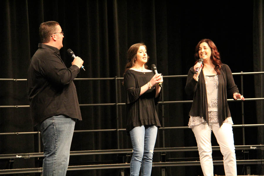 Ronni Jones (12) sings with her family for her senior spotlight.