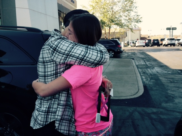 Auntie Kim and I hug in the parking lot after showing her my new haircut.