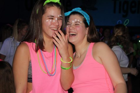 Laughing side by side, Cat Elking (11) and Ashley Jakubeck (12) enjoy their time at the Dance for Charity Neon Night.
