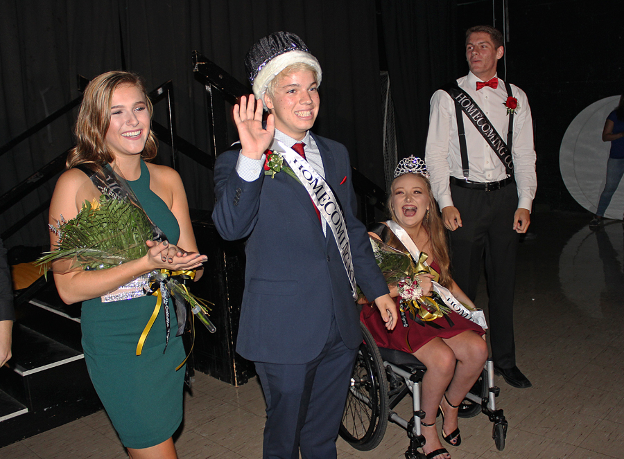 With fellow court members Abbi Baker (12), Queen Sophia Martino (12), and Brad Hartmann (12), JP Latreille (12) waves at the crowd after being crowned.