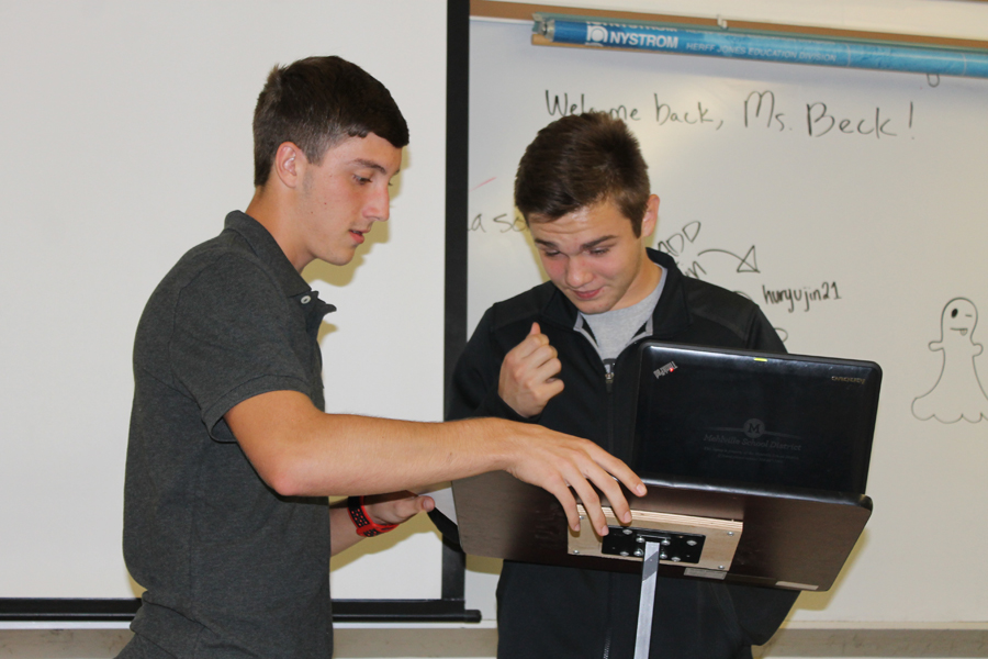 2016-2017 political science members Nick Delucia (12) and Brandon Mumma (11) participate in a political science debate on Oct. 13 2016.