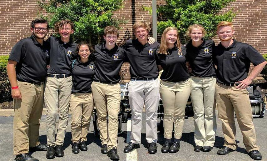 The+OHS+percussion+ensemble+groups+up+for+a+picture+at+Mozingo+on+Aug.+26.