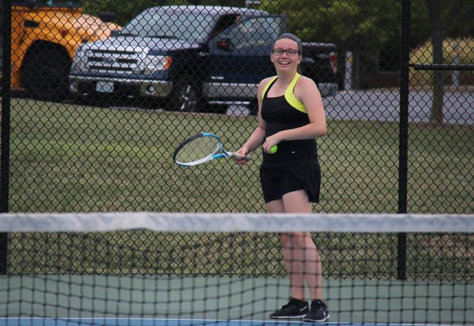 Dalia Dzekic (12) smiles with racquet in hand at the Sept. 12 match against Lafayette.