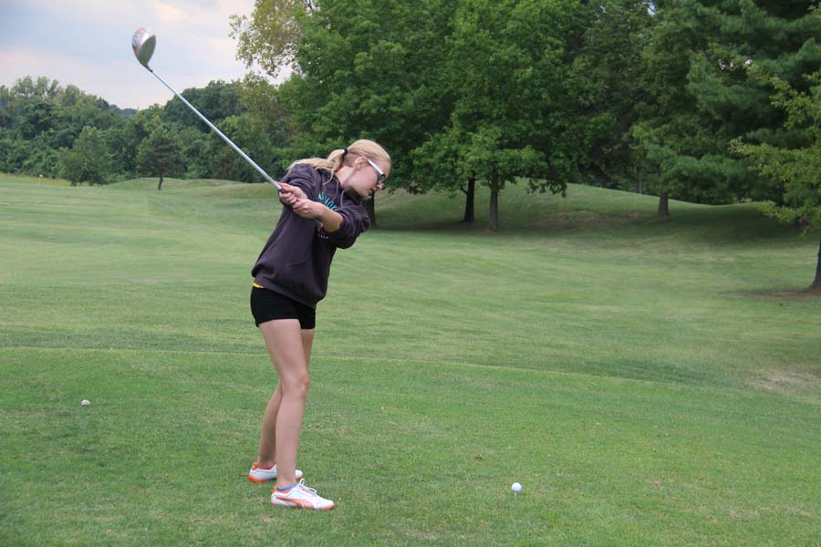 Kayla Landford (9) swings her club toward the ball at practice on Aug. 28.