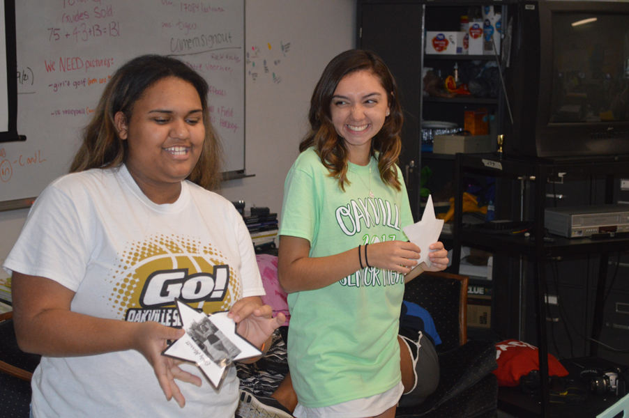 Sierra Uko (12) and Rachel Delgado (12) announce their first shining star winners on Sept. 21.