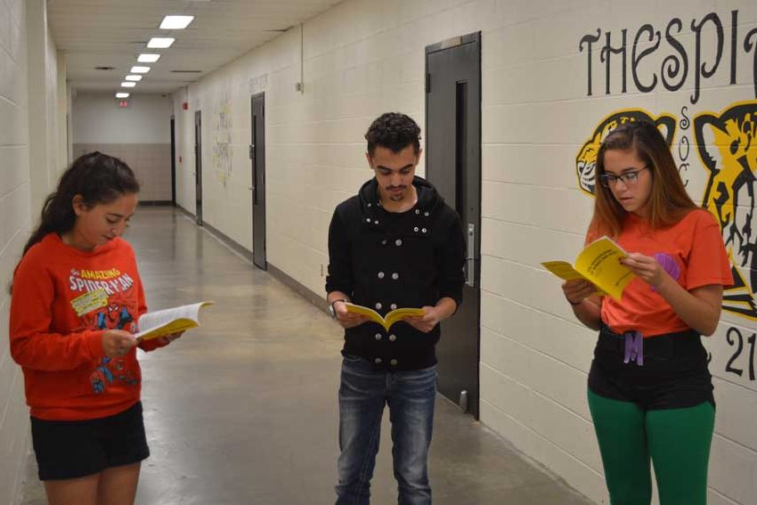 Sophia Indelicato (12), Dakota Nellesen (11), and Kerri Mcfarland (12) practice reading their scripts on Sept. 8 in preparation for the fall play.