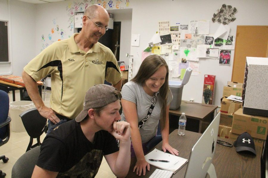 Mr.Jeff Kuchno works with broadcast students Max Rodenbeck (12) and Taylor Zapf (12).