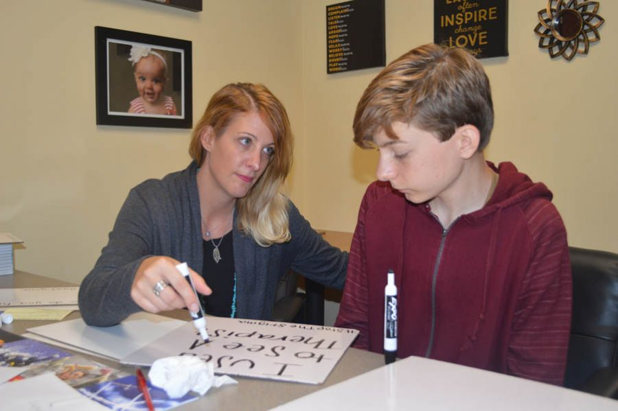 Ms. Leah Black works with a student to plan Suicide Awareness Week on Oct. 20 during ANP.