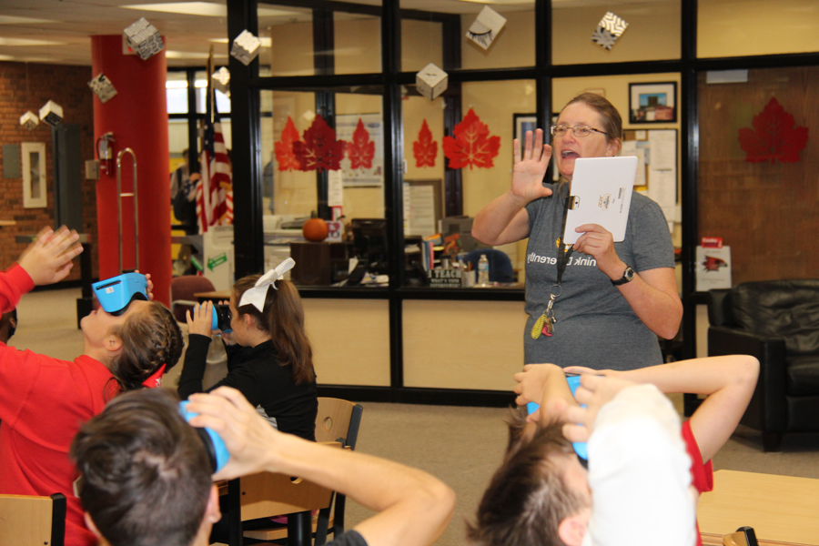 Ms.Pfeifer instructs her students as they use the new vision glasses on Sept. 29.