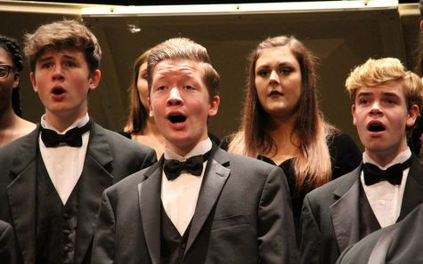 "Singing ""Wana Baraka"", Nathan Gallop (11), Caden Turner (11), and Thomas Schartner (10) perform with Concert Choir Mixed at its annual Fall Concert on Nov. 2."