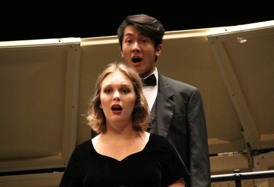 Kristin Steinbrueck (12) and Louis Luong (12) perform in the fall choir concert on Nov. 2.