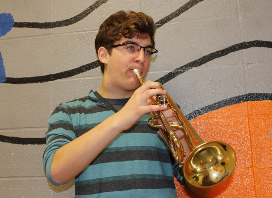 One+of+six+band+members+to+make+All-Suburban+band%2C+Conrad+Bucholtz+%2812%29+practices+his+instrument+in+the+band+hallway.