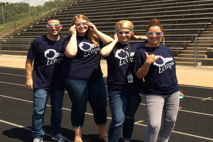 New+english+teachers+Matthew+Holborow%2C+Katie+Wolf%2C+Amy+Crean%2C+and+Natalie+Jeney+show+off+their+Eclipse+wear+on+Aug.+21+on+the+OHS+football+field.