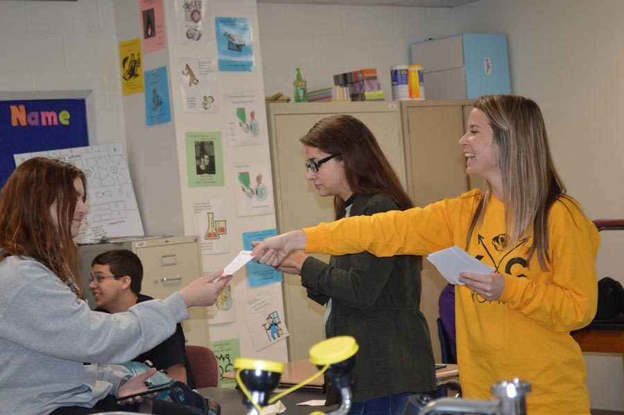 Smiling at her student, science teacher Ms. Kelsey Tuntze hands Allison Harvey (12) her personalized note during ANP on Oct. 27.