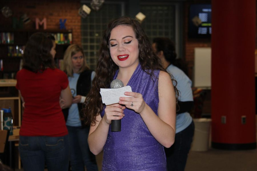 Lilly Jansberg (12) performs as Selena Quintanilla in the library on Dec. 1. Jansberg made her costume by hand.
