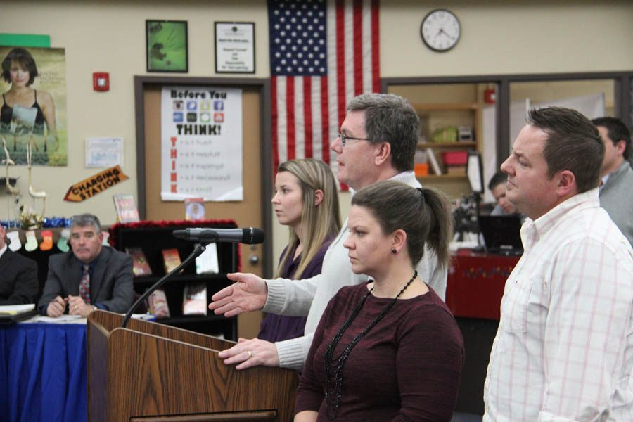 Assistant Principal Mr. Brian Brennan addresses the school board along side the rest of the committee at the meeting on Dec. 14.