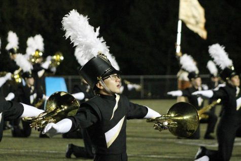 Colin Akers (10) performs during football half time on Sept. 8.