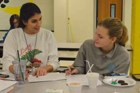 Ms. Samantha Bhambri assists a math student at Cookies, Cocoa, and Cramming on Dec. 15 2015.