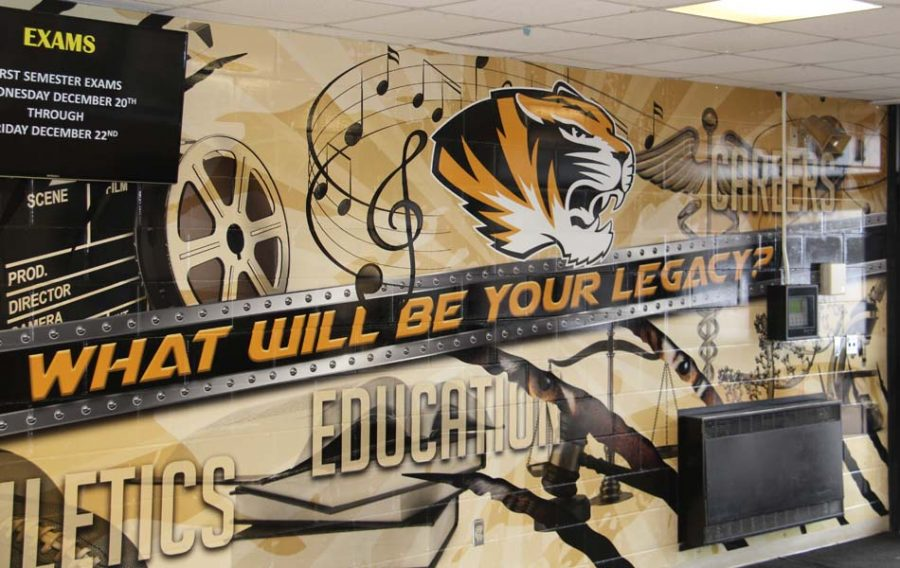 The mural welcomes visitors into the school in the front foyer.