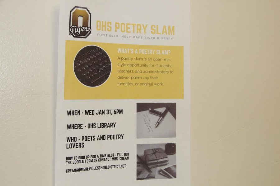 Poetry slam poster hangs on the wall on Jan. 26.