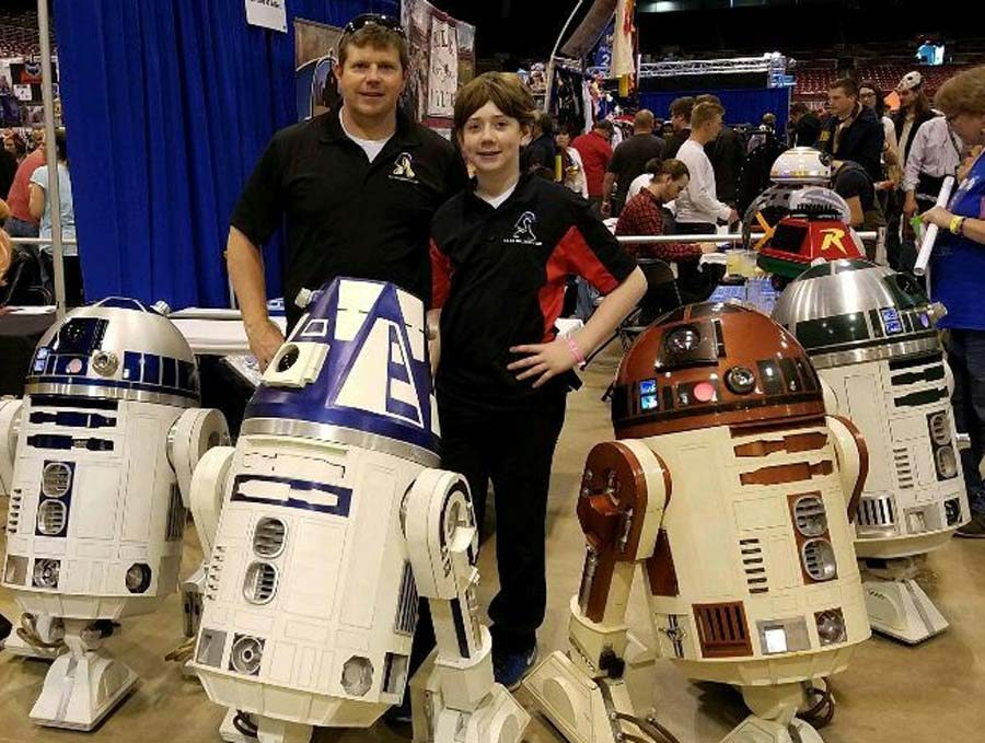 Justin Crawford poses for a picture with his dad at a Wizard World.