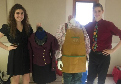 Chloe Willmering (12) and Jacob Kujath (12) pose for a picture with their FCCLA STAR competition pieces they created.