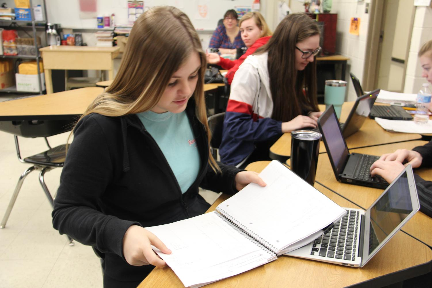 Madi Strohm (12) flips through her notes in Mrs. Quesenberry's ANP as she works on her homework on Feb. 14.