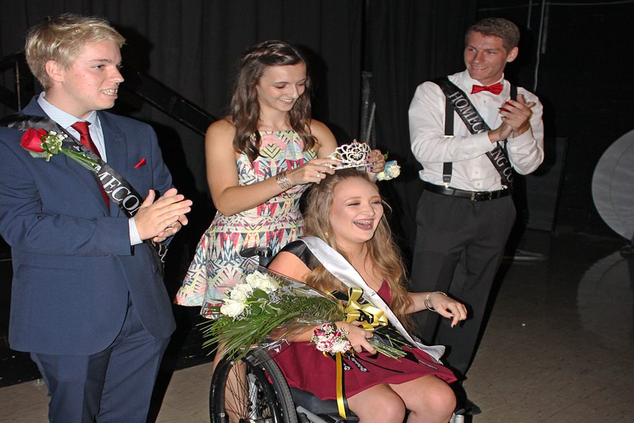 With a big smile on her face, Sophia Martino (12) is crowned Homecoming Queen on Sept. 9.