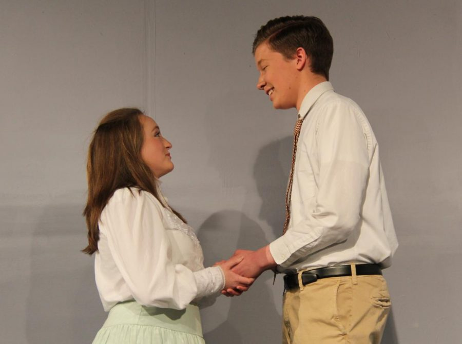 Taylor Zapf (12) and Caden Turner (11) hold hands as Turner confesses his feelings for Zapf.
