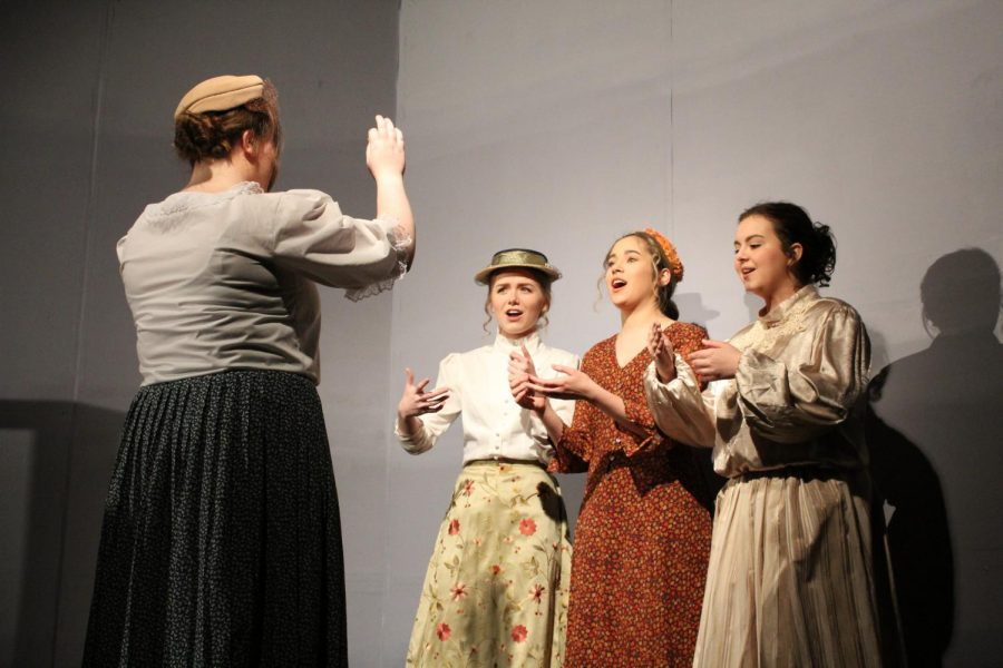 The ladies of the town rehearse at choir practice.