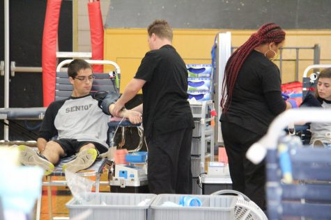 Greg Davidson (12) donates blood during OHS blood drive.