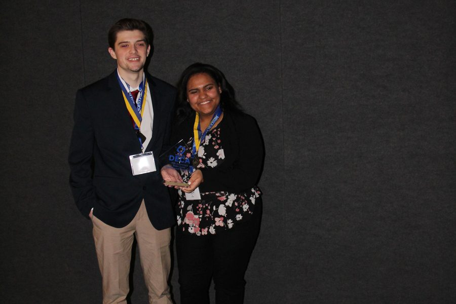 Sean Maltagliati (12) and Sierra Uko (12) pose for a picture after being awarded the opportunity to attend Nationals.