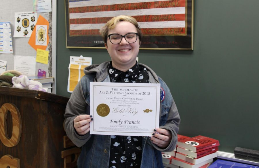 Emily Francis (11) poses with her certificate during AP Language on April 12.