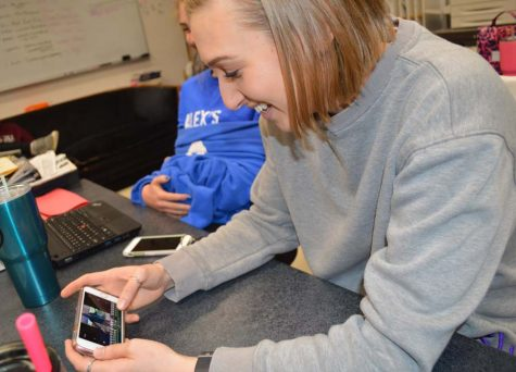 Hannah Baker (12) puts the finishing touches on her project on her phone during ANP on April 16.