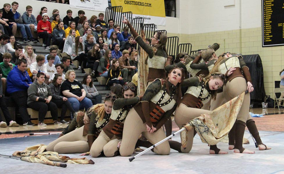 Winter Guard strikes beginning pose before performing in the Spring Pep Assembly On April 10.