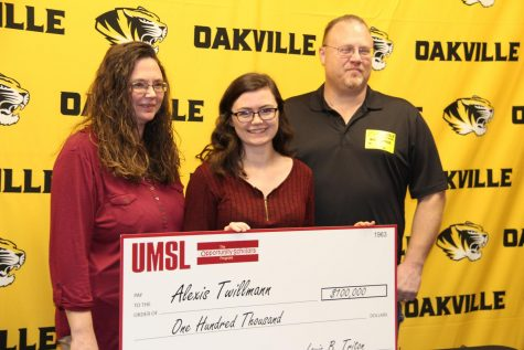Lexi Twillmann (12) smiles with her big check from UMSL in the OHS library.