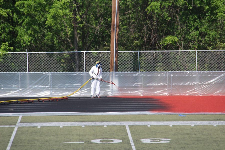 As the school year comes to a close, the track begins to be painted red.