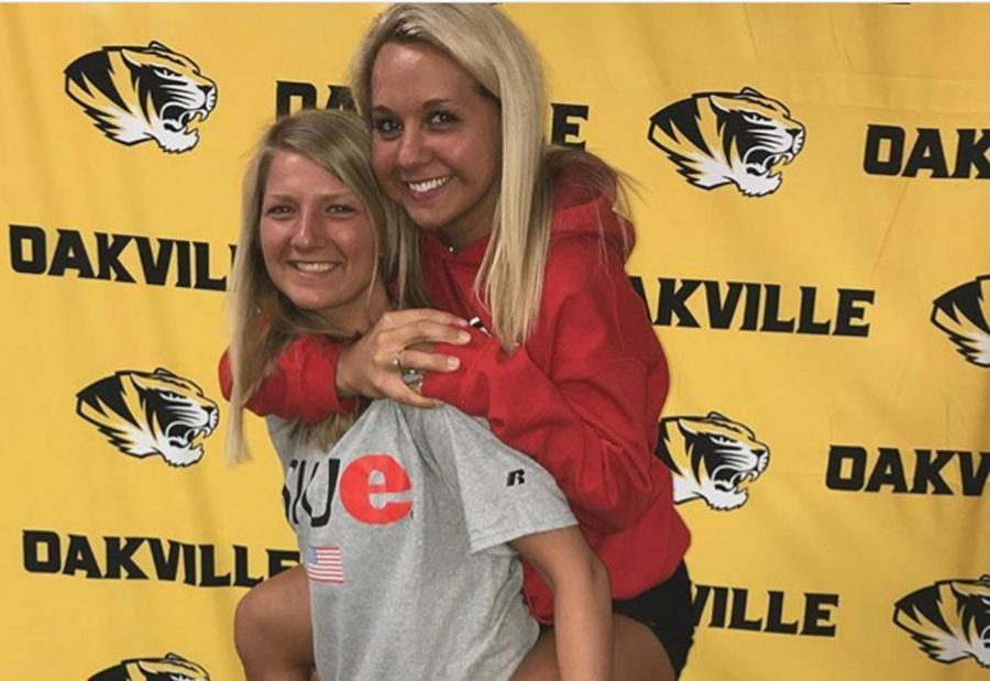 Kayla Klipsch and Ashley Guardado pose for a picture at athletic signing day in the OHS library.