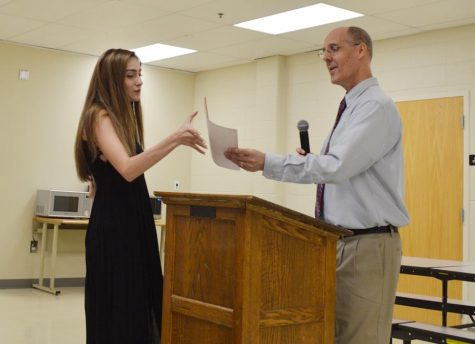 Melanie Neff (12) receives her award at the Journalism banquet on May 16.