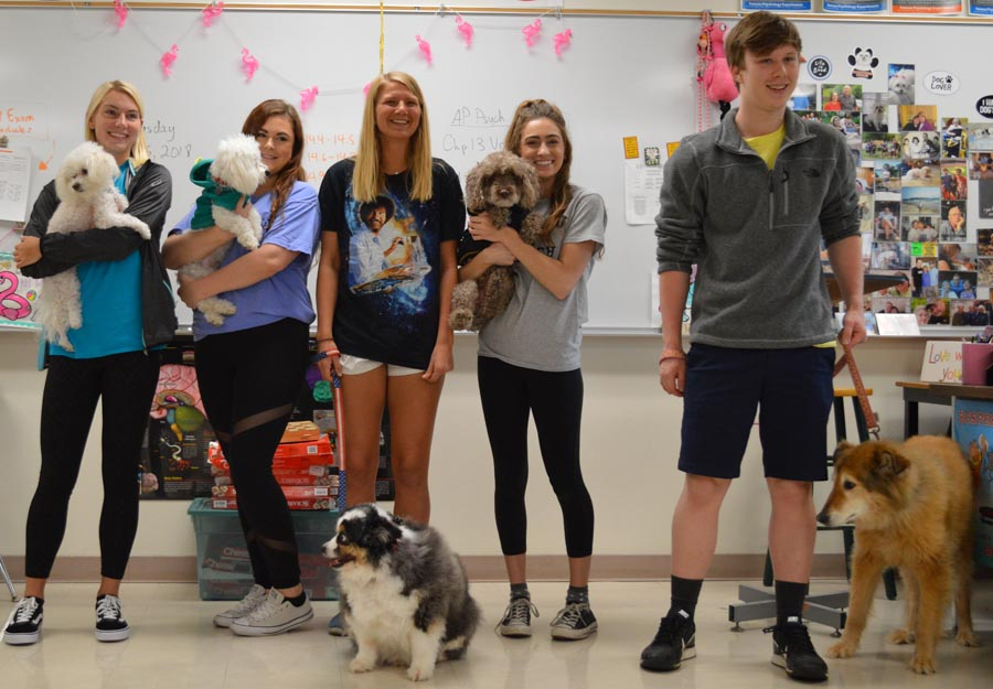 Students in Ms. Caton's class show off their dogs.