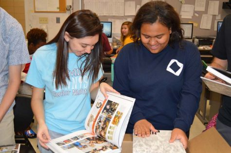 Yearbook Editors in Chiefs Rachel Delgado (12) and Sierra Uko (12) smile in amazement as they see the book for the first time on April 26.