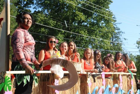 "The varsity cheerleaders are all smiles on their ""Moana"" themed float during the Homecoming Parade on Sept. 28."