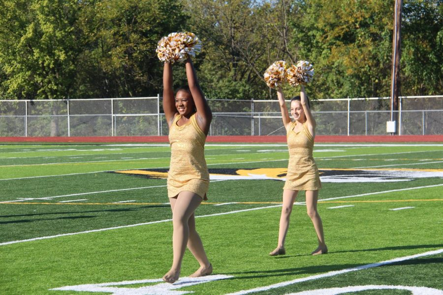 Madiah Parker (12) and Emily Clements (9) perform during the Homecoming assembly.