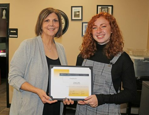 Morgan Allen receives her National Merit certificate after she was announced a semifinalist.
