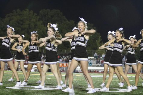 Cheerleaders performing at an OHS football game.